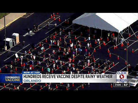 Hundreds receive vaccine despite rainy weather - WKMG News 6 ClickOrlando