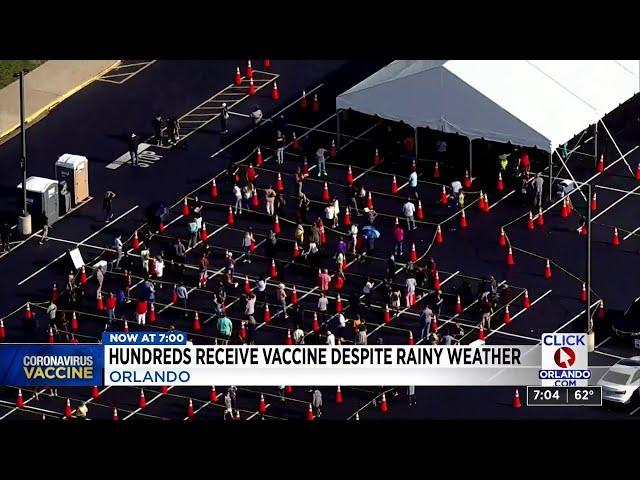 Hundreds receive vaccine despite rainy weather