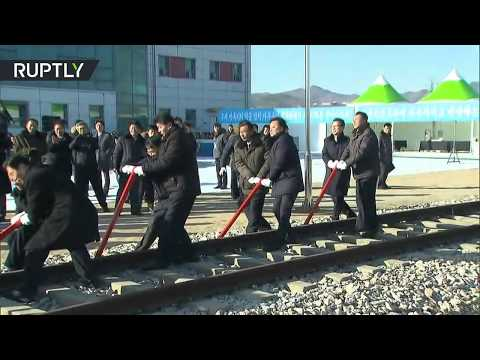 A historic moment: North and South Korean officials link railroads across border