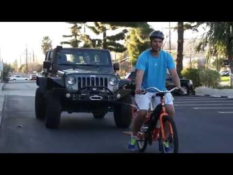 electric-bike-tows-5000-lb-jeep