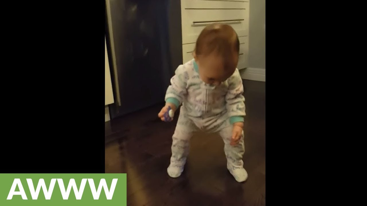 baby dances to dad
