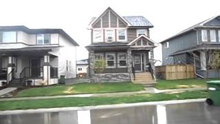 drive by of 1244 Ravenswood Drive Airdrie Alberta 2