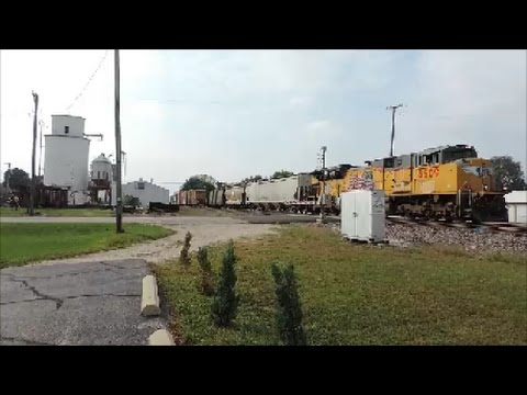 UP 8509 leads a mixed freight east in Malta IL with UP 8386 as a mid DPU