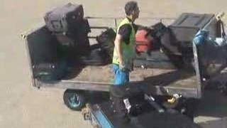 ground crew messing up with bad suitcases