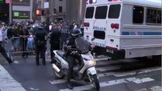 NYPD police bus, vans & scooter team- protest on Occupy Wall Street - one year anniversary