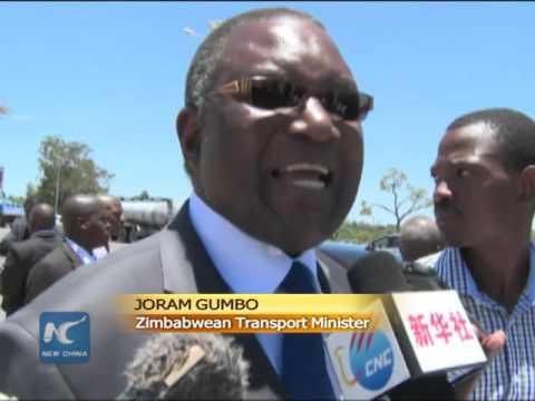 Zimbabwe's Robert Mugabe opens new airport road ahead of Xi's visit
