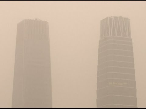 Sand, Dust Blown up by Strong Wind Shroud Beijing, Lowering Visibility
