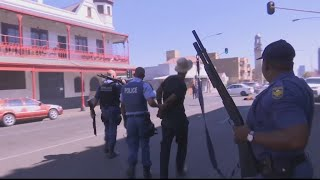 Dozens arrested after looting and violence in South Africa