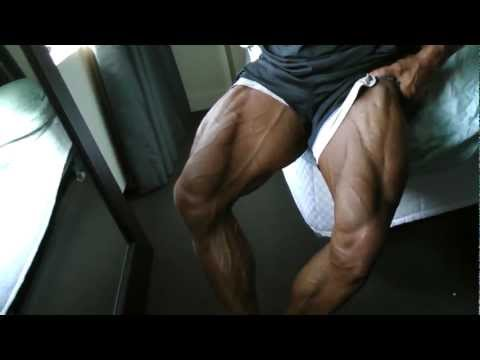 Greg Doucette IFBB PRO X2X athlete Flexing Legs before earning Pro card