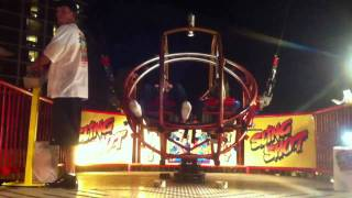 """Mom and I ride the """"Giant Slingshot Ball of Death"""" at Daytona Beach."""