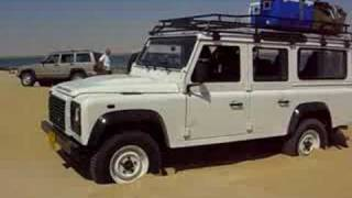 Defender stuck in sand. and drives itself  without driver