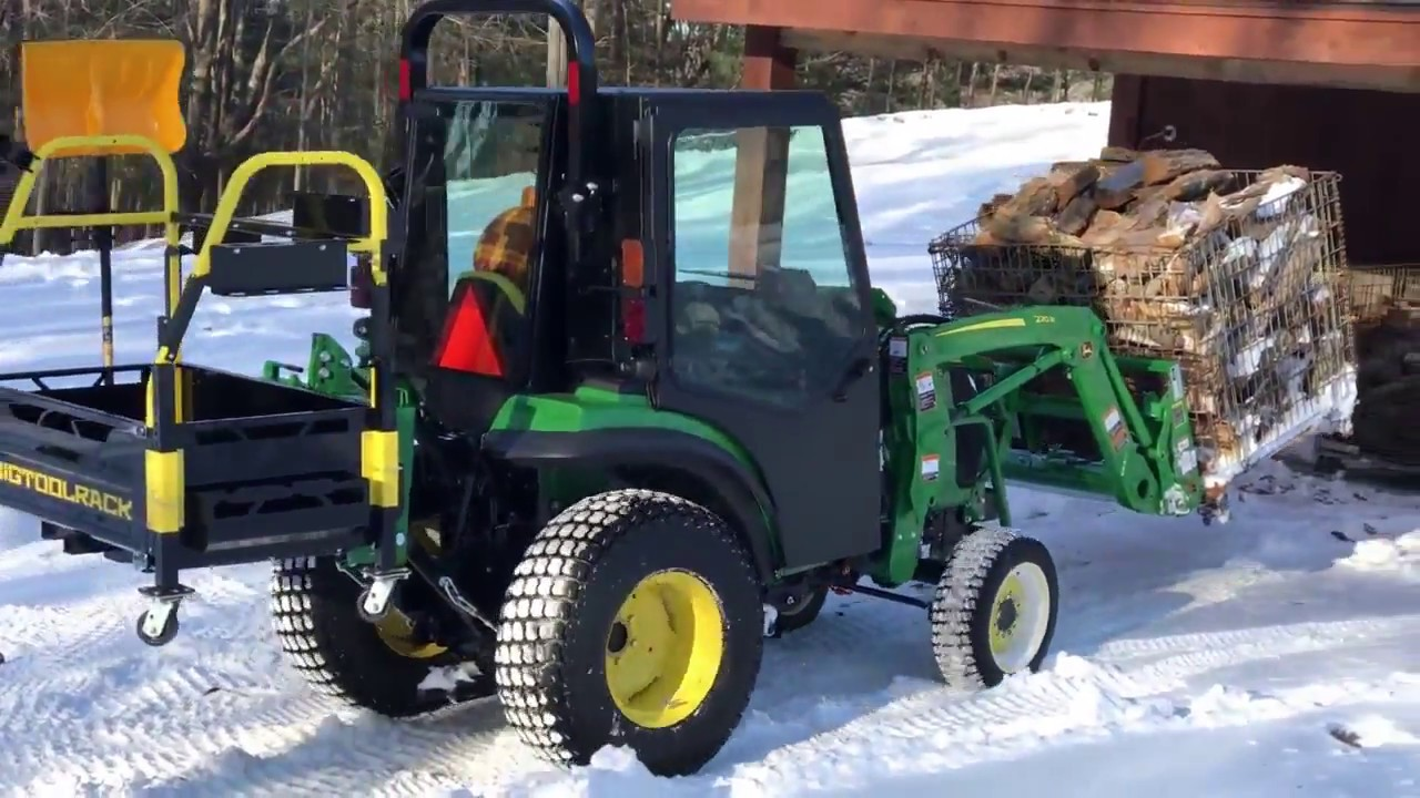 Bigtoolrack for ballast moving firewood on a John Deere 2038r with New  Curtis Cab installed