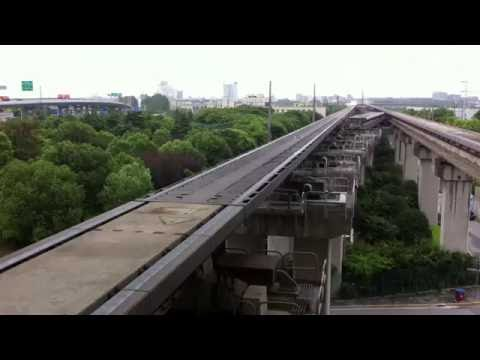 Shanghai Maglev Entering Station and Accelerating to Full Speed