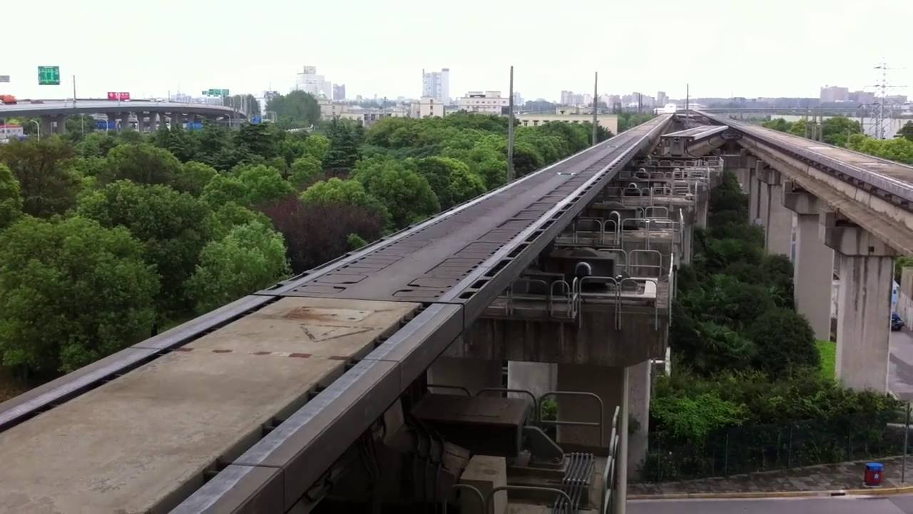 Shanghai Maglev Entering Station and Accelerating to Full Speed ...
