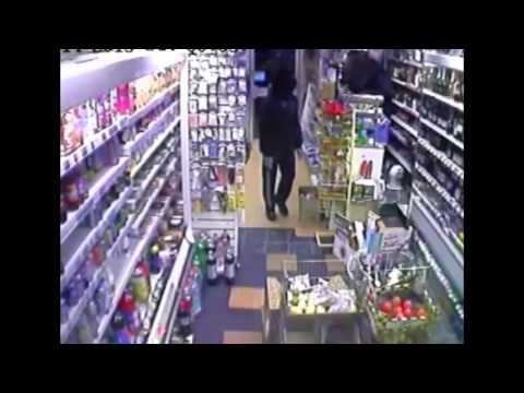 CCTV of armed robbers with sword and machete in Mitcham
