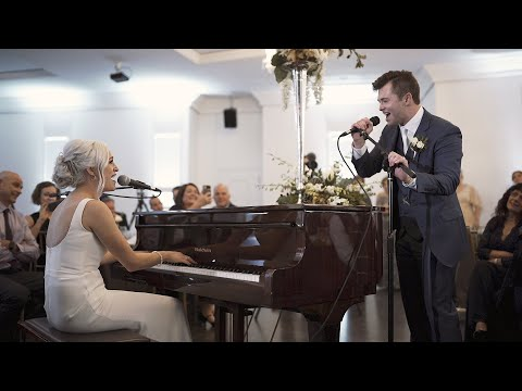 couple-surprises-wedding-guests-with-a-duet-~-ashley-&-alex-~-the-empire-room,-omaha,-ne