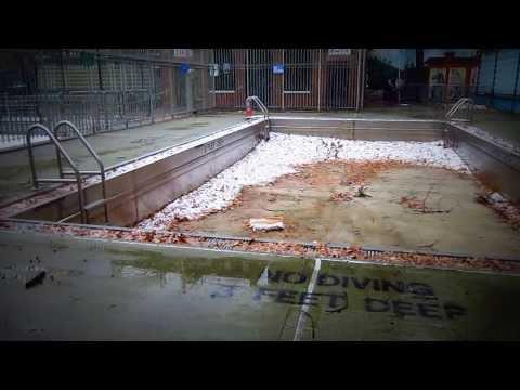 Snow falling in empty swimming pool