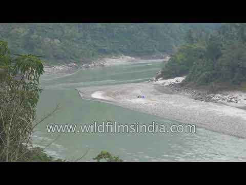 Brahmaputra leaves mountains and enters plains of Arunachal and Assam, as a massive river