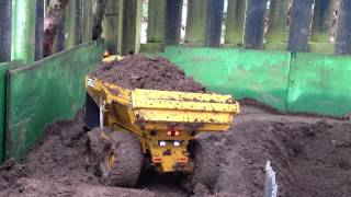 Premacon THS Bell 35 Dump Truck working in the mud
