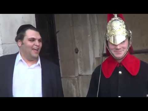Royal guard laughing at tourists jokes