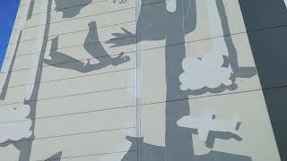 Millo from Italy is implementing his vision on a wall of an apartment building at Vapaudenkatu 65.  Italialainen Millo toteuttaa visiotaan kerrostalon päätyyn osoitteessa Vapaudenkatu 65.