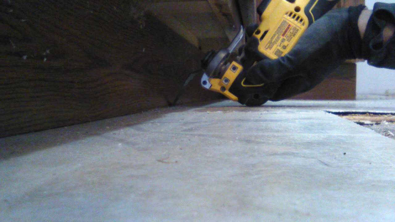 How to cut floor around kitchen cabinets for lock in ...