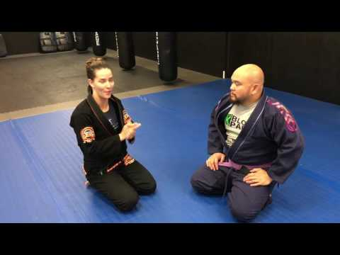 DFKC Fighter Professor Andrea showing an Omoplata to armbar transition