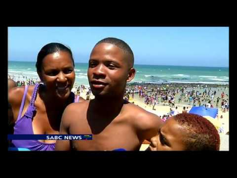 Thousands of people flock to celebrate New Year's Day on Muizenberg beach
