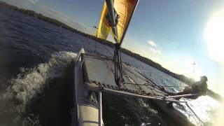 Sailing a Hobie 16 catamaran while hiked out on the trapeze and going fast!!!