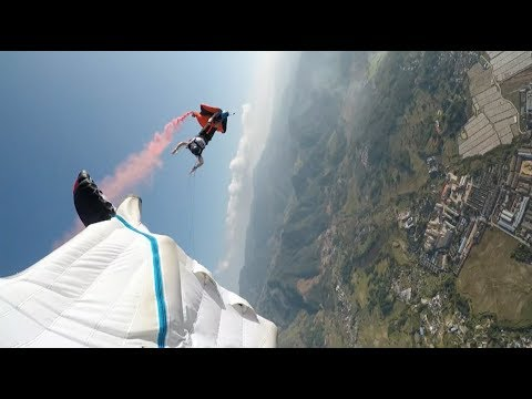 Wingsuit Flyers Complete Flying Carpet, Mid Air Rotation in Southwest China