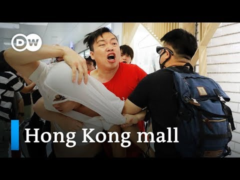 Hong Kong pro-democracy and pro-Beijing protesters clash at mall | DW News