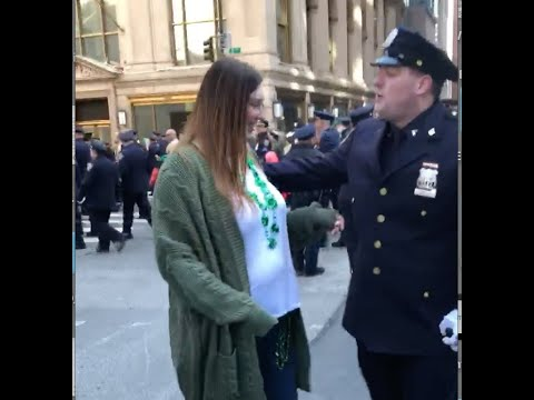 NYPD officer drops to one knee at St. Patrick's Day Parade