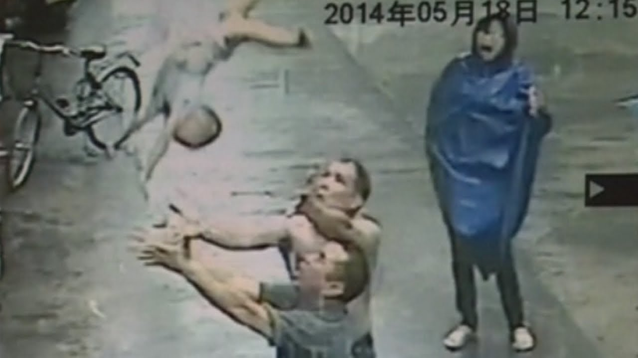 Shocking CCTV: Man catches baby who falls out of two storey building -  YouTube