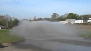 Deere 250D Articulated Dump Truck with 5,000 gallon water tank (rear spray heads)