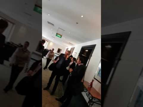 Brian Tonna in meetings at the Hilton while office is pseudo-raided