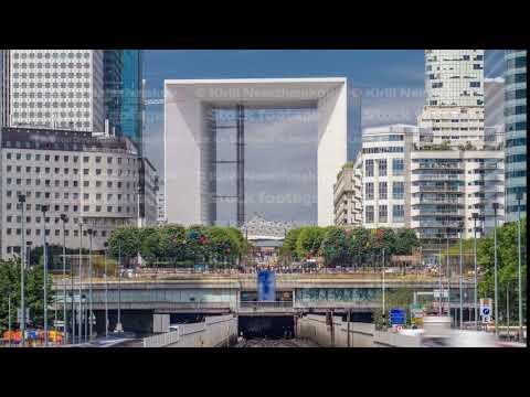 Office buildings in modern part of Paris - La Defense timelapse. Paris, France