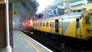 Trian on fire muizenberg station