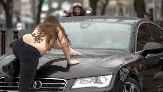 TOPLESS FEMEN activist jump on Dominique Strauss-Kahn