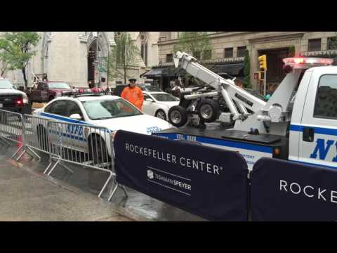 """MUST SEE TO BELIEVE"" - NYPD TOW TRUCK ALMOST TOWING AWAY A NYPD CRUISER DURING PRES. OBAMA'S VISIT."