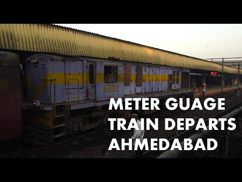 Meter Gauge train morning departure from Ahmedabad : Parallel action with BG Shunter..