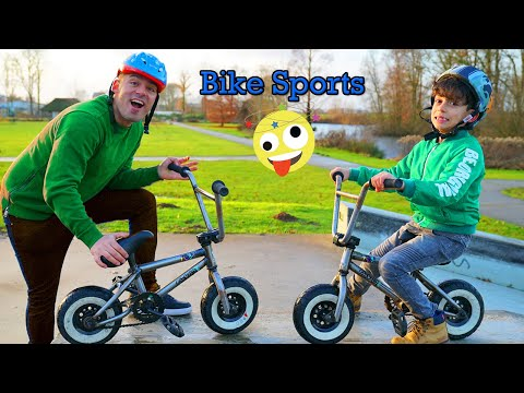 Jason And Alex Play Bike Sports In Park