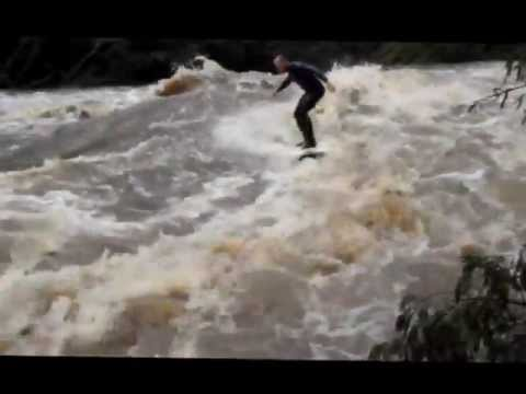 Surfing the Nahoon River standing wave on a fish.wmv