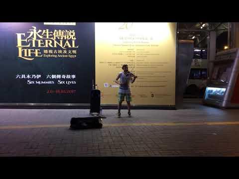 At Hong Kong ( a man playing a music )