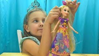 Księżniczki Disneya, lalka Roszpunka Magiczna Sukienka