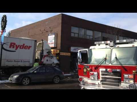 Transport truck crashes into buildings in Tottenham