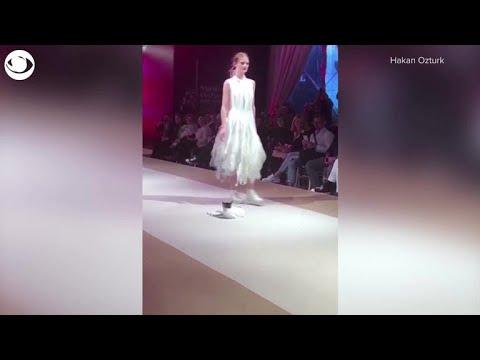 fb205137dc Cat crashes fashion show runway - YouTube