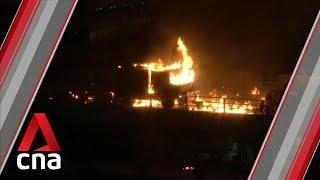 Hong Kong police vehicle set on fire near PolyU