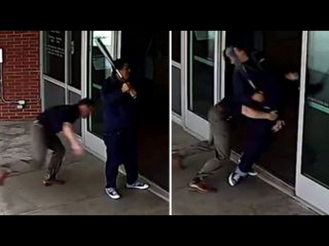 Cop blindsides bat-wielding man outside police department