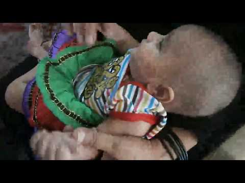 health worker doing polio immunization technique in india