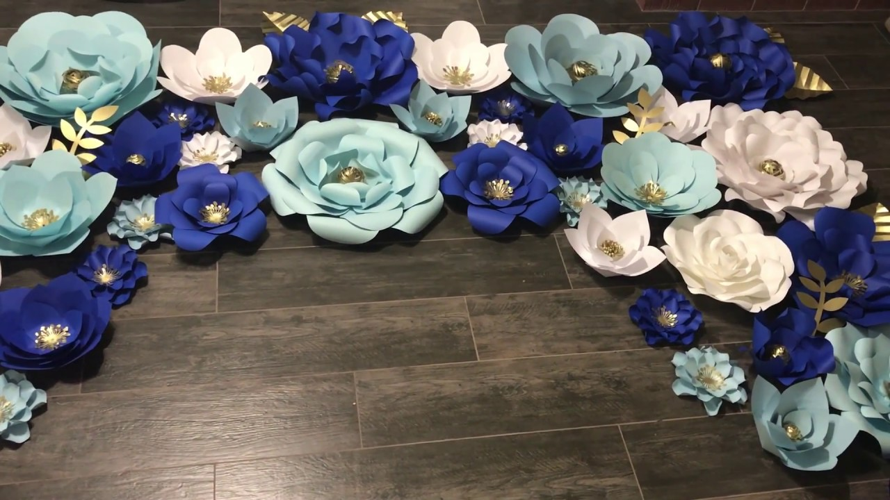 Paper flower backdrop with royal blue  baby blue  white and gold     Paper flower backdrop with royal blue  baby blue  white and gold accents   Big paper flower backdrop